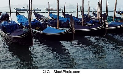 Only gondolas on the background of water - Only gondolas on...