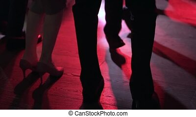 Only legs close up. People dance a lot of fun. Slow-mo. Dancing in nightclub, party, celebration