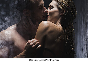 Shot of a young couple taking a shower and kissing passionately