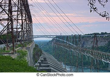 Sir Adam Beck hydroelectric power generating facility in Ontario Canada and the Niagara River flowing beneath the Queenston-Lewiston bridge
