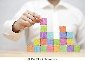 ontwikkeling, concept, zakelijk, kleurrijke, stapelen, man's, houten, blocks., hand