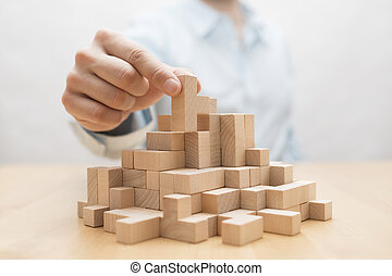 ontwikkeling, concept, zakelijk, stapelen, hand, houten, blocks., man's