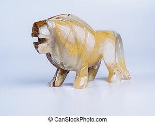 Onyx lion isolated on white background close up.
