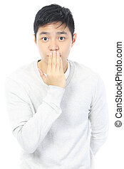 Oops!  - A teenager covering his mouth