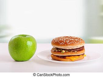 opción, de, sano, y, malsano, comida., dieta, concept:, manzana verde, y, hamburguesa