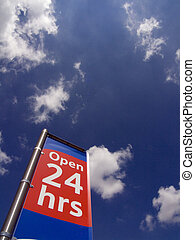 Open 24 Hours sign in a supermarket