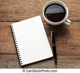 Open a blank white notebook, pen and cup of coffee on wood desk
