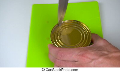Open a jar of canned fish - Knife open a jar of canned fish....