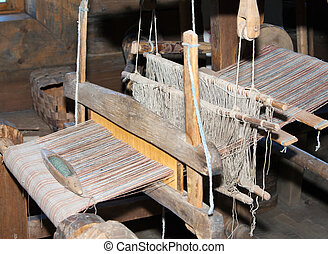 Open-air museum of  ancient wooden architecture, interior of the room of the weaver. Vitoslavlitsy, Great  Novgorod. Russia.