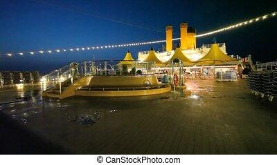 night swimming pool on top deck of cruise ship
