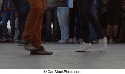 Open air party. Many couples dancing outdoors latina dances,...