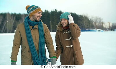 Open Air Skating-Rink - Slow motion of couple approaching...