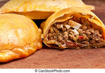 Open beef empanada - Beef Empanada fill close up. The ...