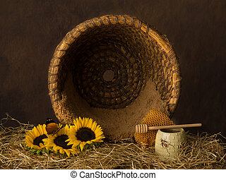 Open beehive basket and flowers