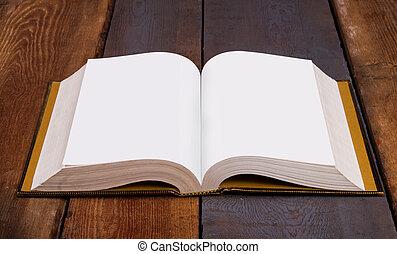 Open Bible on wood