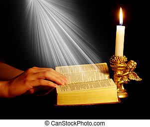 open bible  - Praying hands on open bible