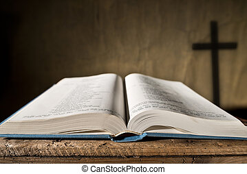 open bible and cross an opened bible and plain wooden cross stock