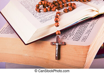 Open Bible with rosary