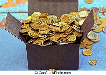 open black box full of yellow coins standing