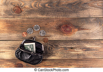 Open black leather pocket wallet with coins.