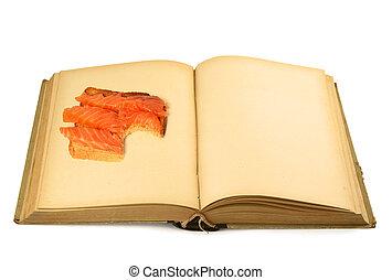 open blank book with sandwich