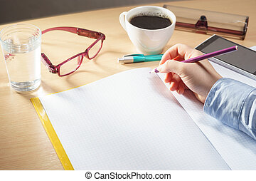 Open blank notebook with woman hand