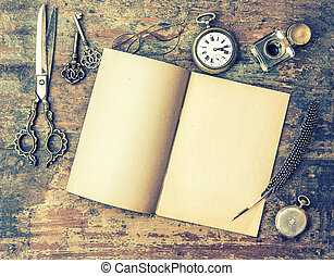 Open book and antique writing tools on wooden table. Feather pen