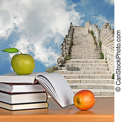 Open book and apple