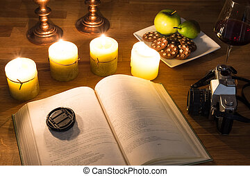 Open book and candles