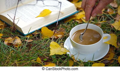 open book and cup of coffee