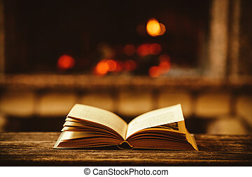 Open book by the Fireplace with Christmas ornaments. Open storyb