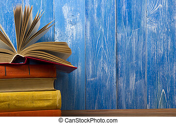 Open book, hardback books on wooden table. Back to school....