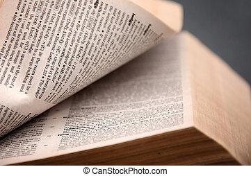 Open book - Massive open book close up detail, warm light.