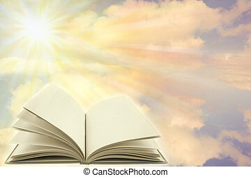 Open book on a heavenly scene. Copy space.