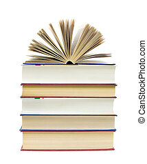 open book on a pile of books on a white background