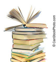 open book on a pile of books