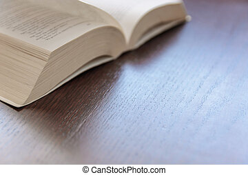 open book on a rustic wooden table