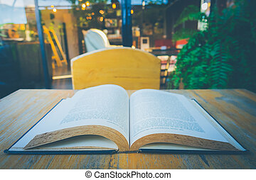 Open book on table in garden