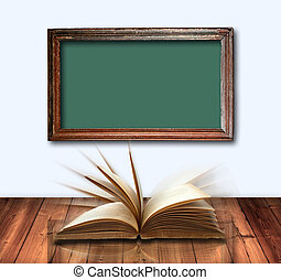 open book on wood table and old Green board