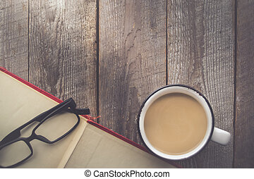 Open Book with Coffee and Glasses on Wooden Background with Copy Space in Vintage Tone