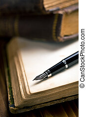 open book with fountain pen - open ancient book with ...