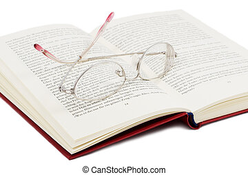 open book with glasses on it