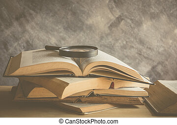open book with reading glasses in the bookshelf