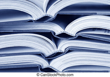 Open Books - Open text books in a pile, in blue tone.