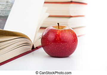 open books with red apple