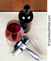 open bottle and wineglass with red wine
