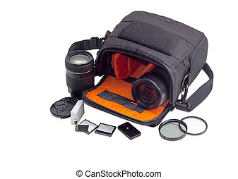 Open camera bag, photo lenses and some photo accessories