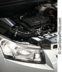 Open Car Hood - Modern Vehicle Engine. Front Part of Vehicle...
