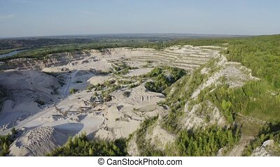 Open cast mine with concentrating mill and rock handler...