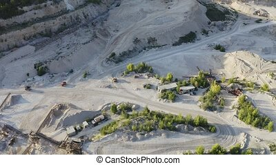 Open cast mine with concentrating mill and rock handler ...